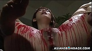 Asian babe receive her privates covered in wax.