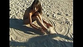 Beautiful fresh faced legal age teenager plays at the beach undressed