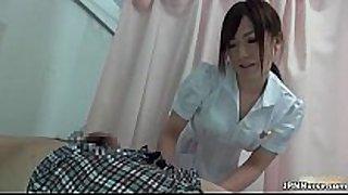 Sexy asian nurse sucks on a dong