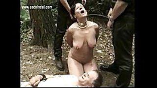 Hot and sexually sexually excited thrall fastened to tree with got playe...