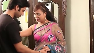Indian teacher in sexy pink bra and sari seducing young guy